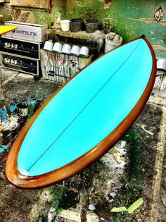 Mayhem Surfboard RockUp model with Root Beer brown bottom and Mint inlay on the deck.