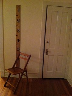 Chair, front hall closet, handmade oversized ruler by TheEmptyHouseStudio, via Flickr