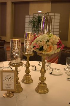 Mercury Candles on top of gold pedastals with a touch of Floral Small Centerpieces, Wedding Consultant, Set Up An Appointment, Just Married, Event Design, Mercury, Touch, Candles, Table Decorations