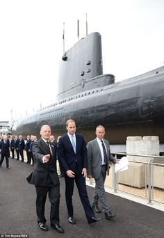 Cheeky chap: During his visit to the Royal Naval Submarine Museum, Gosport, Prince William said it was lucky Prince George was not here. 'I think he'd get up to all sorts of mischief pulling on things,' he said