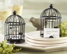 classy little bird cages with candles as table decorations. love it