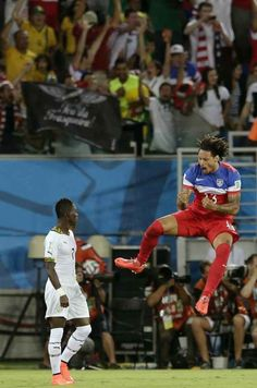 Ghana's Christian Atsu looks back at his goal while United States' Jermaine Jones celebrates Clint Dempsey's goal in the first minute. | USA Holds On To Beat Ghana, 2-1