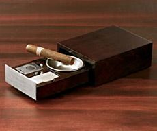 Cigar Lover's Kit ($50) It features an ashtray that easily slides back into a luxe case when your smoking is finished, and to get it started, the box also contains a nickel-plated butane lighter and a cigar cutter. Also makes a great gift for the stogie aficionado in your life.