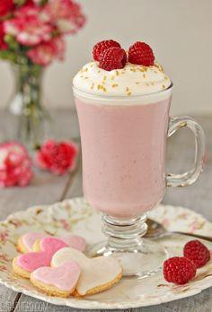 Raspberry White Hot Chocolate ~ raspberries (fresh or frozen), sugar, milk, cream, vanilla extract, white chocolate, whipped cream
