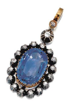 SAPPHIRE AND DIAMOND PENDANT,  CIRCA 1900.  Centring on an oval sapphire weighing 17.69 carats, set within a border of cut-down collet-set circular-cut diamonds.