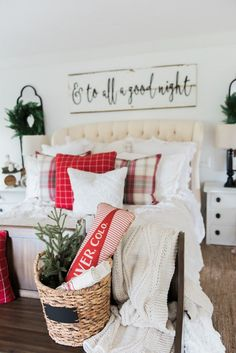 Cozy cheerful farmhouse Christmas bedroom - A must pin for farmhouse & cottage style Christmas decor inspiration! I love the sign about the bed