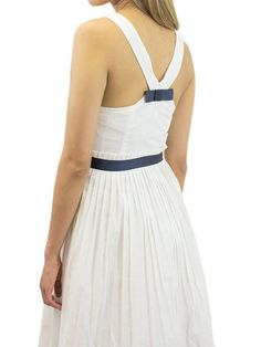 06c2d99c302e1e Here's a cotton sundress whose understated elegance captures Parisian chic  with a nautical flair. Rendered