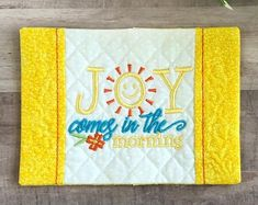 What a cheerful way to start your day! You'll love having this mug rug under your cup while you spend time in God's Word. Get one for a friend or loved one too. Mug rugs make great gifts. This listing is for one mug rug. #joyinthemorning #bibleversemugrug #coffeelovergift Joy In The Morning, Gift Of Faith, Christian Gifts For Women, Embroidered Gifts, Popular Colors, Coffee Lover Gifts, Mug Rugs, Hostess Gifts, Rug Making