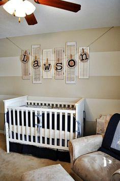 displaying a name above a crib, very unique materials - love the stripes too!