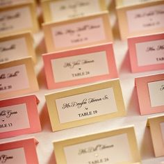 Pink and cream place cards to differentiate food selection.