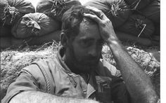 The face of war, thinking of home and a wife he may never see again...