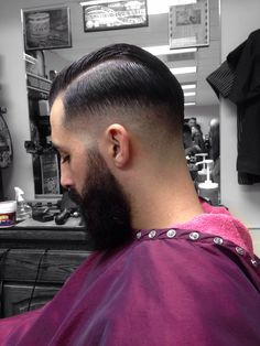 The UKfade, is what this has been named by Elie_the_Barber. It's a SkinFade with a sidePart hairstyle.