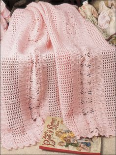 """Your little one will love to snuggle under this beautifully textured, lacy baby afghan. This e-pattern was originally published in The Needlecraft Shop's Afghan Collector's Series. Size: 40"""" x 43"""". Made with fine (sport) weight yarn and size G/6/4mm hook. Skill Level: Intermediate"""