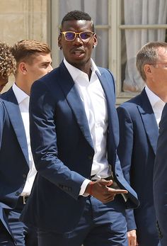 Paul Pogba and teammates arrive at Elysee Palace for a lunch with President of France Francois Hollande on July 11 2016 in Paris France