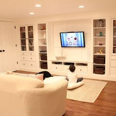 Wall of built Ins out of IKEA Hemnes Cabinets - LauRa Limo - Wall of built Ins out of IKEA Hemnes Cabinets design and decor, basement ideas, home decor, shelving ideas, storage ideas - Basement Makeover, Basement Storage, Basement Renovations, Basement Built Ins, Walkout Basement, Basement Gym, Basement Designs, Basement Walls, Yurts