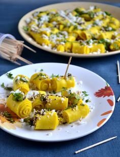 Gujarathi Farsan - Khandvi, GayathrisCookSpot (besan, sour curd, sugar, turmeric, oil, sesame and mustard seeds, asafoetida, curry leaves, green chili, grated coconut, cilantro)