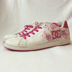 DC Shoes Sz 10W skate sneakers. These skate shoes are just beautiful and gently used. White with hot pink floral design with silver borders.  Super chic color combination with an awesome white DC logo on a hot pink background on back of shoes.  Minor wear and one of the hot pink laces needs to be replaced. Size 10W. DCSHOECOUSA Shoes Sneakers