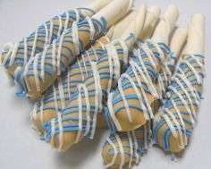 These are made of rawhide chews, but could be a dog treat baked in the shape of a pretzel rod & then iced.