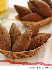 Similar to Middle Eastern kibbeh, these beef-and-bulgar croquettes are seasoned with oregano and mint and served with a tangy yogurt-mint sauce.