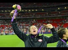 USA forward Abby Wambach (14) celebrates with her gold medal after defeating Japan in the gold medal match during the London 2012 Olympic Games at Wembley Stadium.