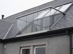 Balustrade solution for a loft on Islay, Scotland. Anodised aluminium handrail drills to the roof timbers and secures the Velux window opening with a frameless glass balustrade and two triangular glass side pan Loft Conversion Balcony, Loft Conversion Bedroom, Dormer Loft Conversion, Loft Conversions, Bungalow Loft Conversion, Terraced House Loft Conversion, Attic Loft, Loft Room, Attic Rooms