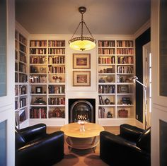 White bookshelves are the way to go so the focus can be on non-white items in the room! It simplifies and highlights beautifully! Small Home Libraries, Small Library Rooms, Cozy Library, Library Shelves, Library Ideas, Home Library Design, House Design, Design Desk, Library Fireplace