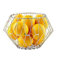 Stainless steel folding wire basket shapes and folds to fit all of your storage needs. It can be used as a basket, fruit bowl, napkin holder, trivet and much more. It's a wonderfully fun piece that will never stop coming in handy. Wire Basket Storage, Wire Storage, Wire Baskets, Fruit Storage, Easy Storage, Storage Containers, Funky Fruit, Bathroom Gadgets, Kitchen Gadgets