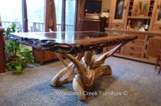 Rustic Redwood Table with Glass by Woodland Creek Furniture in Custom Made Sizes.