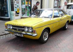 Ford Cortina MK 3 Loved this car. Coke bottle shape. Unusual with the twin headlights. Mine was white