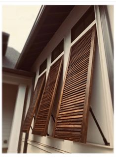 Bahama shutters were installed on this custom home yesterday. Love the color on the cypress shutters.