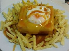 Francesinha à la mode from Porto, Portugal - Darrell Pideon Meals For Two, Main Meals, Portuguese Recipes, Portuguese Food, English Food, Sandwiches, World Recipes, Love Food, Porto Portugal
