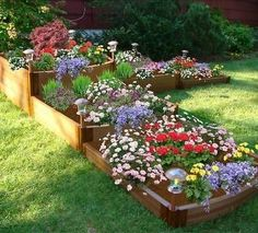 The Two Inch Series 144in. x 144in. x 22in. Composite Split Waterfall Raised Garden Bed Kit captures the Art Deco styling of the movement - sleek horizontal lin