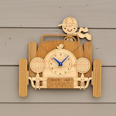 """Our cute vintage wooden Car wall clock design is personalized with your child's name, birthdate and state on the license plate. Perfect for travel or transportation themed baby nursery or kids room decor, our original car design is laser cut from 1/4"""" maple and natural alder wood making this adorable piece of multi-layered artwork a practical heirloom addition for any child's space. Along with hand color, you have a choice of Boy or Girl driver... So cute! We also include a free AA ..."""