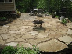 Patio: Outdoor Fire Pit Made Of Stone Tiles Can Be Used For A Party Night from Discover The Aesthetics & Dynamics Of The Flagstone Patio Designs