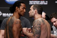 Benson Henderson and Frankie Edgar square off during the UFC 150 weigh-ins at the Pepsi Center in Denver on Friday, Aug. 10, 2012.