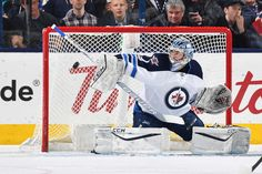 COLUMBUS, OH - APRIL 6: Goaltender Eric Comrie #1 of the Winnipeg Jets blocks a shot during the first period of a game against the Columbus Blue Jackets on April 6, 2017 at Nationwide Arena in Columbus, Ohio. Comrie made his NHL debut tonight. (Photo by Jamie Sabau/NHLI via Getty Images)
