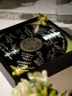 Vinyl record and silver sharpie as alternative wedding guestbook