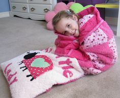 """Quillow"" patterns for kids!  This website has multiple designs for boys or girls.  They can put their feet in the pocket and wrap the quilt around themselves."