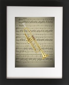 "Trumpet on Sheet Music. Framed & Matted in 8"" X 10"" Black, Wooden Frame. This original art print produced exclusively by CherryPic Junction features a Classic Trumpet over Vintage Sheet Music. It is handmade in small production runs. The print comes in an 9"" X 11"" black wooden frame with white matting. The frame is ready to display in your home right out of the box! This is a dual purpose frame. You can choose to hang it on a wall or display it freestanding on a shelf, table or mantle…"