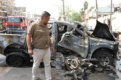 A member of the Iraq security forces looks at the site of a car-bomb attack in Baghdad on Saturday. PHOTO: REUTERS