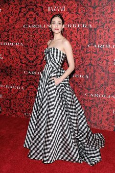 Carolina Herrera dressed Emmy Rossum in a Spring 2017  strapless gingham silk gown with black CH box clutch to celebrate Mrs. Herrera receiving the women's leadership award at Lincoln Center in New York City on Tuesday, December 6th, 2016.