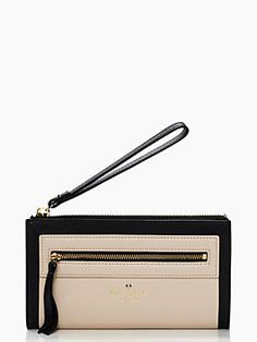 bigger than a wallet, but smaller than a clutch, our new sable wristlet--which features 8 card slots and room enough, inside, to fit an iPhone 6--is the perfect choice for those evenings when you want to keep your essentials at your fingertips.
