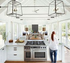 Woman cooking in modern design farmhouse kitchen in Sonoma, CA