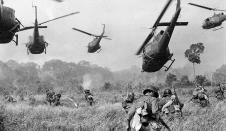 Hovering Us army helicopters pour machine gun fire into the tree line to cover the advance of South Vietnamese Ground troops in an attack on a Viet Cong Camp 18 miles north of Tay Ninh, Vietnam, Northwest of Saigon near the Cambodian Border Vietnam War Photos, Vietnam History, South Vietnam, Vietnam Savaşı, Vietnam Tours, War Photography, Photography Ideas, Iconic Photos, Rare Photos