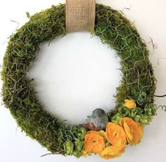No matter how you embellish them, moss and chicken wire together always look very spring-like and are especially inviting as a moss wreath for your door. - Everyday Dishes & DIY