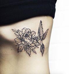 Hummingbird tattoo on side by Anastasia Martynova