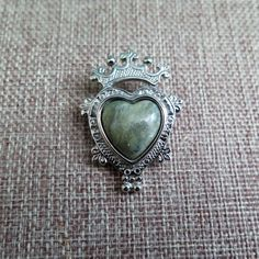 This is a really beautiful Scottish Luckenbooth brooch, c.1970s-80s.  The Luckenbooth is a Scottish love token (for more information on its origin, please see the About section of my store).  The heart and crown are engraved silver tone, and at its centre there is a lovely moss agate heart.  It measures 1 3/4 x 1 1/4 and has a rollover C safety clasp which is in good working order.  A lovely item which is sure to be treasured.
