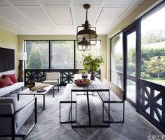 When it came to the decor, the homeowners and designer were in sync, favoring clean-lined furniture—like the ebonized-oak dining table and leather sling chairs—but avoiding extraneous flourishes such as window treatments. The carefully chosen access Sunroom Decorating, Sunroom Ideas, Porch Ideas, Lush, Living Room Decor, Living Spaces, Zen, Oak Dining Table, Dining Room