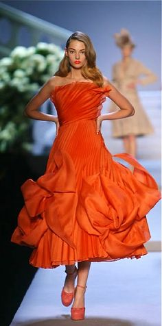 """Dior... now I LOVE the colour and the swirl of the pleating... not thrilled with the """"flames"""" and the shoes look clunky but with something like the shoes that Queen Mathilde wore on Belgium's National Day..."""