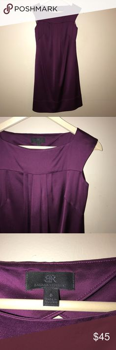 Adorable Banana Republic black label dress Black label Banana Republic fully lined, silk like dress. Cranberry color. Cute cutout in the back of the dress. Excellent used condition Banana Republic Dresses Midi